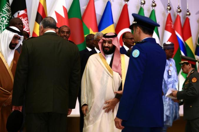 Saudi Crown Prince Mohammed bin Salman (C) stands with chiefs of staff of a Saudi-led Islamic military counter terrorism coalition during their meeting in Riyadh