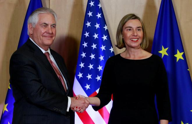 U.S. Secretary of State Tillerson is welcomed by European Union foreign policy chief Mogherini at the EU council headquarters in Brussels