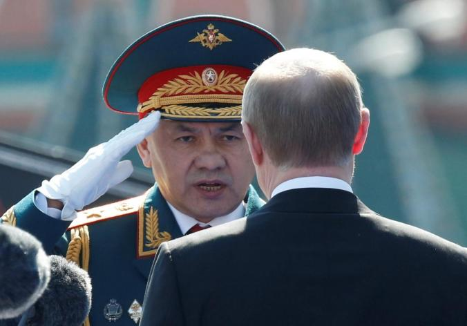 FILE PHOTO: Russian President Putin and Defence Minister Sergei Shoigu attend Victory Day parade to mark end of World War Two at Red Square in Moscow